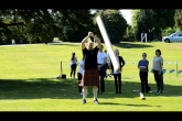 Caber Tossing at Highland games experience team building event