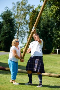 Tossing the caber at Highland games experience